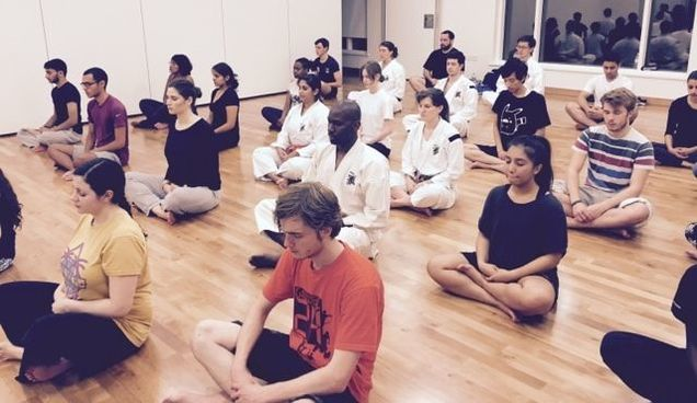 Practicing meditation at a Shorinji kempo self-defence beginner's class